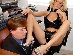 Young innocent looking blonde Erin Moore dominating a slave in his office.