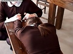 Laid face down on the table and caned on her bare exposed buttocks - tears of pain