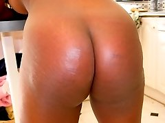 Dark skinned lovely spanked otk on her big bottom in the kitchen