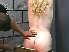 Fat chick with hands bound above her head gets her ass paddled