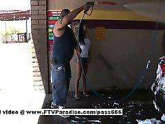 Hot brunette girl in a car wash