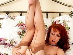 Red is showing off some sexy vintage nylons, feet encased in pink stilettos!