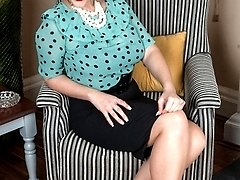 Buxom Victoria in classy attire opens up for very racy nylon fun and frolics!