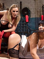 Drinking coffee on a sunny after noon, Rose Rhapsody spots hot dominatrix Mona Wales walking...