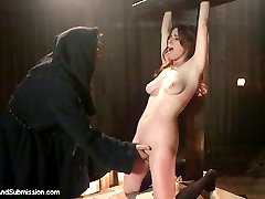 Penny lives out her fantasy as the Adulteress who is punished and humiliated by a cruel priest in the presents of her ex-husband and his new wife.  When the satisfied witnesses leave, the father dominates Penny with his erect cock.