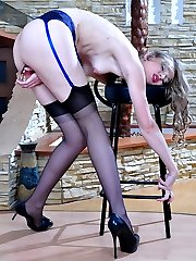 Smashing babe takes a glass dildo out of her black stocking for solo play
