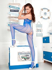 In a fishnet combo of blue body suit and open crotch white net tights, Becky is 100 dressed for...