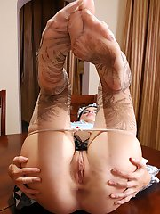 Lusty chick in patterned pantyhose shows her feet and opens her pussy lips