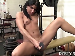 Vita and her big black dildo in the gym