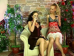 Lesbians plays with a dildo in pantyhose