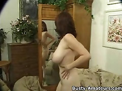 Busty Kathyns sucking her own tits and playing her pussy