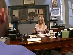 Dirty blonde girl spreads her legs on the desk for some serious pussy eating