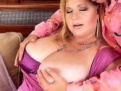 Big busty BBW licks cum on her massive tits