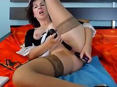 Lovely Brune mature masturbates