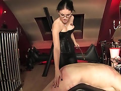 Dominate Mistress caning her bound slave
