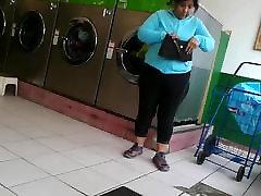 Mature latina at laundromat