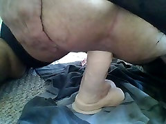 playing with dildo wearing stockings