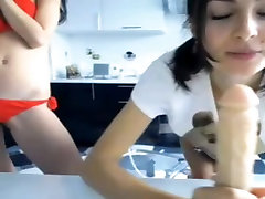Teen sucking and blowing dildo cock