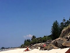 Cum for topless milf spreading her legs on the beach!