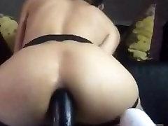 Bareback slut rides black dildo