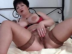 Horny mature with big boobs masturbating with a dildo till orgasm