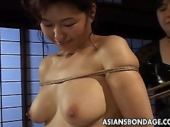 Mature bitch gets roped up and hung in a japanse inlaw session
