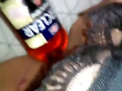 fat whore fucks her squirting pussy with liquor bottle