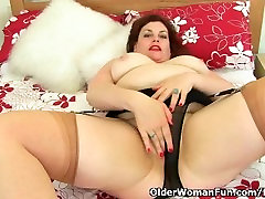 UK milf Vintage Fox works her supple pussy with a dildo