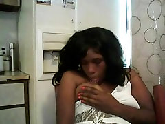horny black girl smoking in kitchen