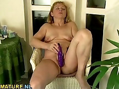 Small titted mature dildoing her hairy pussy