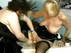 Two mature lesbians are using fingers and are also fisting pussy