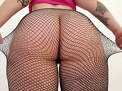 Pale goth chick shows her big butt in black stockings.