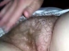 Rubbing and fingering her hairy mature pussy