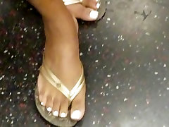 Candid ebony feet white toe nails posing