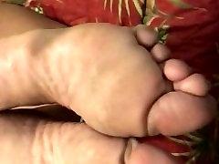 Lightly spanking tall skinny Ebony feet soles