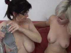Chubby granny with black glasses playing with