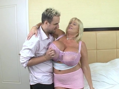 Blonde mature with huge silecone tits