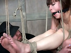 Tied up and restrained porn model Alexa Nova moans with pain in the dark torture room