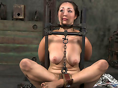 Flexible girl is tied up and chained in tricky position in oily ass round clip