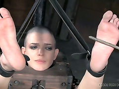 Horny bondage master puts his slave in extreme position and punishes her hard