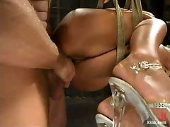 Tied up and hung above the floor gagged brunette gets pussy fucked hard