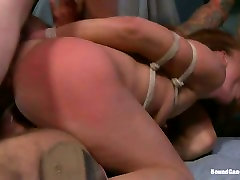 Several aroused studs fuck hard throat and pussy of one bondage whore