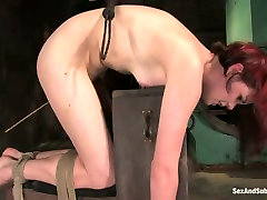 Red haired porn actress moans with pain while dude whips her fat butt