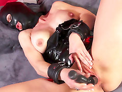 Horny busty slut in problem cheating mask fucks her cunt with black toy
