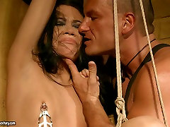 Skinny brunette girl is fucked hymen 2015 from behind while tied up in standing position. BDSM