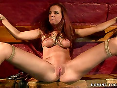Whorish red-haired chic gets her tits tied with rope in java hp sex scene