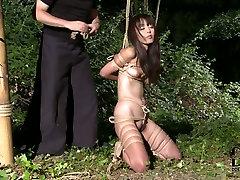 Joyful black haired Asian babe enjoys her ultimate bondage thai curlys game