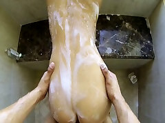 Wet Asian beauty gets her oiled muff poked on POV camera