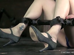 Horny slut with well-developed breasts gets punished in dungeon