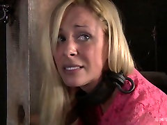 Blonde nympho Cherie Devill tied to the pillory pleases herself
